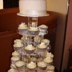 all white cupcakes with silver cases
