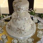 white wedding cake with crystal flowers