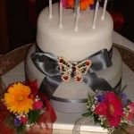 2 tier grey cake with butterfly brooch