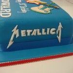 blue metallica cake with guitars