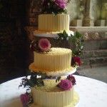 white chocolate tube wedding cake with pink flowers