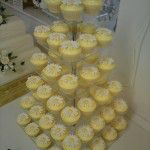 white chocolate belgian cupcakes with daisies and yellow buttercream