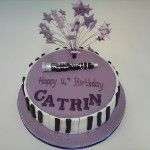 musical piano and clarinet cake