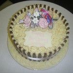 white and milk chocolate cake with handmade flowers