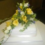 one tier wedding cake with fresh flowers