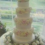 Stacked cake with ivory and pink roses