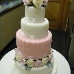 snowflake pink wedding cake with roses