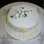 cake with yellow bows and twists