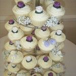 white chocolate shelled cupcakes with purple roses and freesias