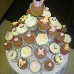 cupcakes with pink roses and butterflies on 38 stand