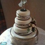 cake with criss cross burgundy ribbons