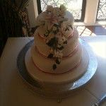 3 tier round wedding cake with diamontes and pink ribbons