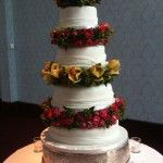 wedding cake with fresh flowers inbetween the layers