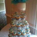 ice blue cupcakes with feather top tier