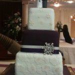purple middle tier wedding cake with lace and snowflake pattern