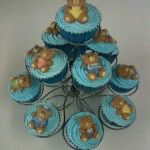 baby blue cupcakes with teddy bears