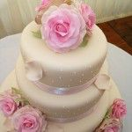 iced 3 tier cake with vintage pink roses and petals