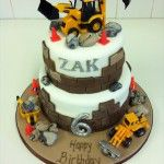 builing cake with plastic trucks