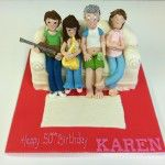 family sitting on sofa cake