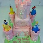 castle cake with all the disney princess