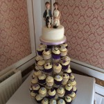 Cupcake wedding cake with handmade bride and groom