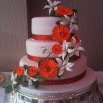 3 tier cake with trailing gerbera&#039;s and lilies