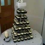black cupcakes with square top tier
