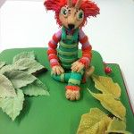 cake with faeble and woodland scene on top