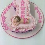 number one cake with baby and ruffles