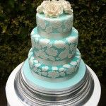 3 tier duck egg blue iced cake with ivory lace pattern on top