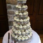 white flower cupcake tower with cream buttercream