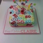 50th birthday cake with starts on wires, multicoloured