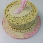 white chocolate cigarello cake with pink handmade shoe
