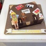 brown suitcase cake with model and dog