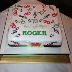 welsh themed cake with musical notes and 70's