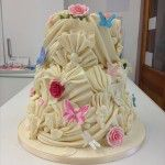 white chocolate three tier fan and rose cake