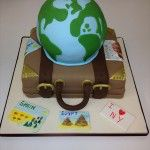 suitcase and world globe on top cake