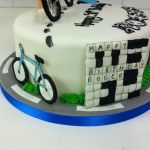 cycling and crossword on cake