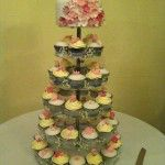pink flower cupcake wedding with top tier