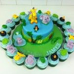 jungle cake with matching cupcakes