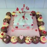 pink hearts cake with matching cupcakes