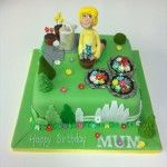 gardening cake with flowers fence trees and watering can
