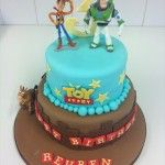 two tier toy story cake with plastic characters