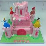 two tier castle cake with plastic figures