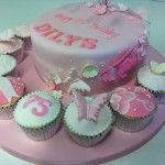 pink butterfly cake with matching cupcakes
