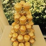 yellow butterfly and flower cupcake tower