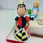 handmade queen of hearts on alice in wonderland cake