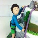handmade sugar rock climber on cake