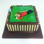 golf cake with chocolate tubes, milk and white