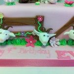 white and brown sugar rabbits cake with goats